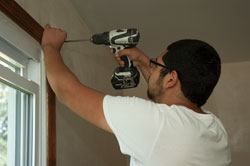 student using cordless drill-driver
