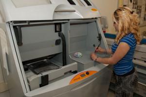 A student operates a 3D printer.