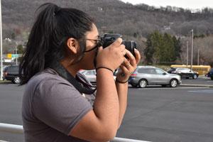 Advertising student using a digital SLR camera