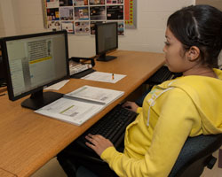 A female student works at the computer.