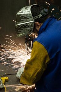 adult student grinding steel