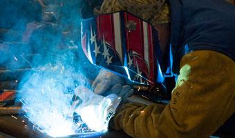 Adult student welding
