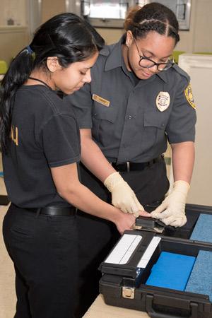 PSS students practice taking fingerprints